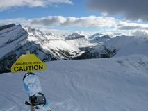 Caution Ignored. Snowboarding the back bowls of a Rockies mountain Stock Photo