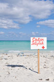 Caution jellyfish sign. A caution jellyfish sign at a beach in cuba Royalty Free Stock Photo