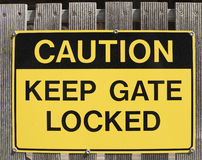 Caution, Keep Gate Locked Sign Stock Photography