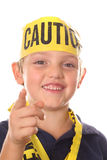 Caution kid pointing. Isolated on white Royalty Free Stock Photography