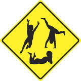 Caution kids playing. Traffic sign to slow down and to be aware of playing children ahead Royalty Free Stock Photo