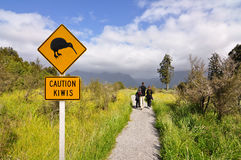 Caution kiwi panel on a trail Stock Photography