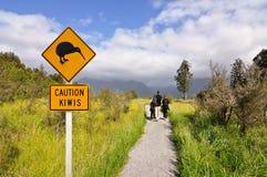Caution kiwi panel on a trail. New Zealand Stock Photography