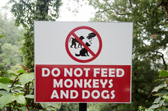 Caution label feeding animal Royalty Free Stock Image
