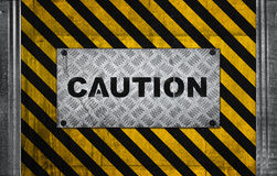 Caution label metal panel Royalty Free Stock Image