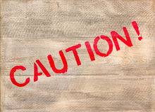 Caution Label on Wooden Crate Royalty Free Stock Images