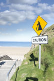 Caution loose rocks or landslide sign Stock Images