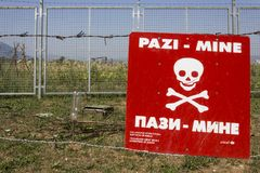 Free Caution Mines Sign In A Minefield In Sarajevo Stock Photography - 103888072