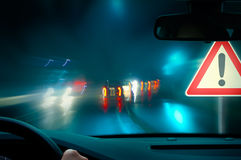 Caution - Night Driving Stock Photography