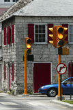 Caution: No Left Turn. Traffic light showing a yellow Caution, No Left Turn sign Royalty Free Stock Photo
