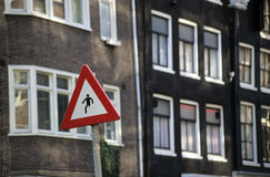 Caution One Legged Man. A caution sign in Amsterdam depicts a man walking with one leg missing royalty free stock photography