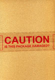 CAUTION is this package damaged? Stock Photography