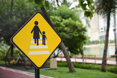 Caution people crossing traffic sign Royalty Free Stock Image