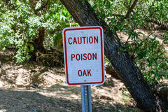 Caution poison oak warning sign Stock Photos