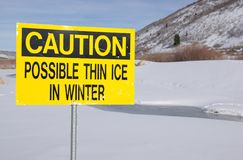 Caution possible thin ice sign. Stock Photos