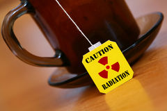 Caution radiation. An image of label of tea with sign radiation royalty free stock photography