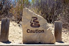 Caution Rattlesnakes Sign Stock Photos
