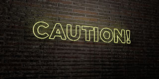 CAUTION! -Realistic Neon Sign on Brick Wall background - 3D rendered royalty free stock image Royalty Free Stock Images