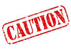 CAUTION red stamp text. On white Stock Photos