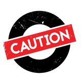 Caution rubber stamp Stock Photo