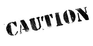 Caution rubber stamp Stock Image