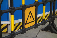 Caution safety sign. In the construction site Royalty Free Stock Photo