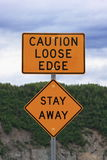 Caution sign. Yellow caution sign warning to stay away from loose edge Royalty Free Stock Image