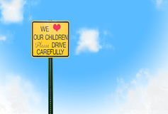 Caution sign. With bright sky and fluffy clouds Royalty Free Stock Photo