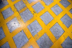 Caution sign,dangerous stripes,yellow path in parking garage area. royalty free stock images