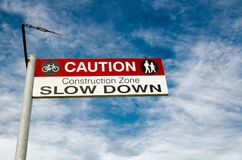 Caution Sign for a Bicycle rider to slow down in the construction area. A Caution Sign for a Bicycle rider to slow down in the construction area stock photography