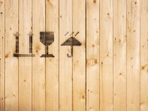 Caution sign black spray paint symbol on wooden Panel container royalty free stock image