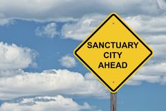 Caution Sign Blue Sky - Sanctuary City Ahead. Caution Sign Blue Sky Background - Sanctuary City Ahead Stock Images
