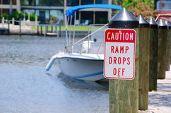 Caution sign at boat ramp Stock Images