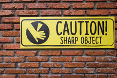 Caution Sign On Brick Wall,Beware Sharp Object Royalty Free Stock Photography