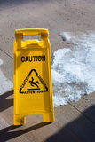 Caution sign. Bright yellow caution sign for an icy deck Royalty Free Stock Photo