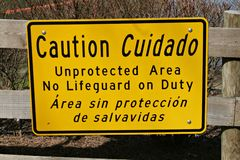 Caution Sign At Lake Royalty Free Stock Photography