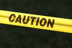 Caution Sign over a dark background Stock Photo