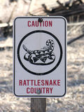 Caution Sign - Rattlesnake Country. A cautionary sign showing that you are now hiking in rattlesnake country royalty free stock photos