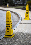 Caution sign. On a sidewalk Royalty Free Stock Images