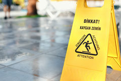 Caution sign slippery floor is tile Stock Photos