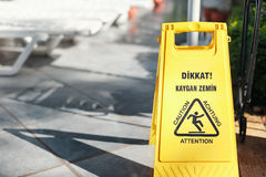 Caution sign slippery floor is tile Royalty Free Stock Images
