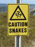 Caution Sign Snakes at Mobile Ferry Stock Image