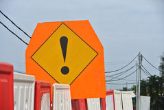 Caution sign in triangle board with exclamation mark at the construction site. PERAK, MALAYSIA – SEPTEMBER 17, 2015: Caution sign in triangle board with stock images