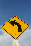 Caution Sign. Turn left at warning sign Stock Images