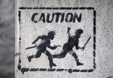 Caution sign. On the wall in Genoa, Italy Royalty Free Stock Photos