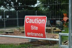Caution site entrance sign. Royalty Free Stock Image