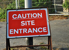 Caution site entrance sign Royalty Free Stock Images