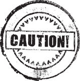 Caution skamp. Abstract grunge rubber stamp with the text caution Stock Image