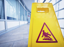 Caution slippery surface sign Stock Images