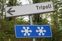 Caution! Snow in Tripoli. A road sign warns that there may be snow in Tripoli stock photos